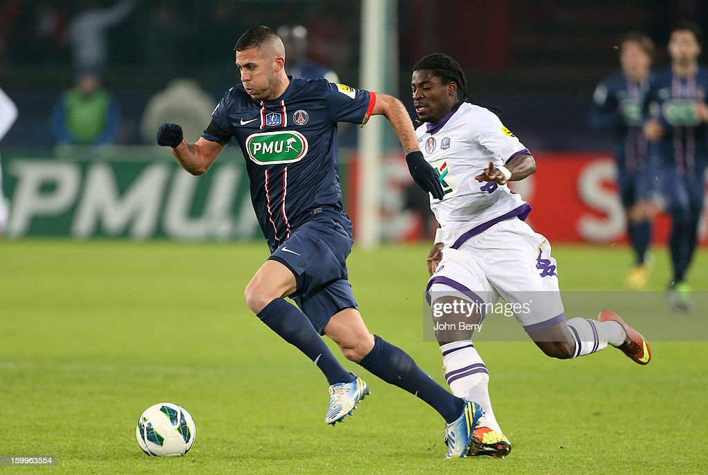 <a gi-track='captionPersonalityLinkClicked' href=/galleries/search?phrase=Jeremy+Menez&family=editorial&specificpeople=648636 ng-click='$event.stopPropagation()'>Jeremy Menez</a> of PSG (L) in action during the French Cup match between Paris Saint Germain FC and Toulouse FC at the Parc des Princes stadium on January 23, 2013 in Paris, France.