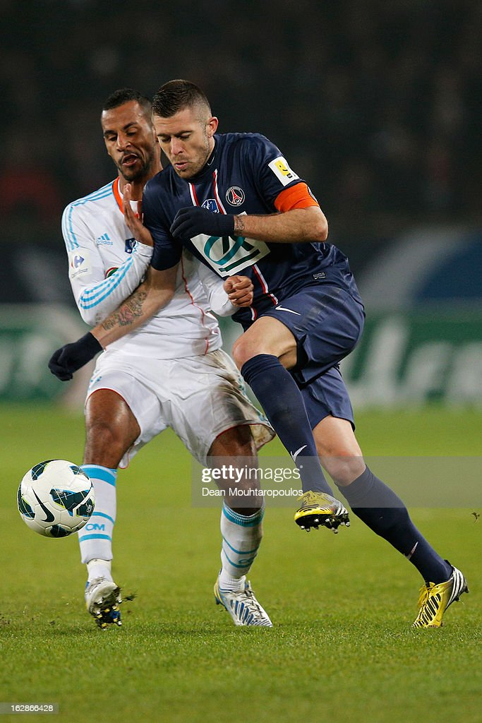 <a gi-track='captionPersonalityLinkClicked' href=/galleries/search?phrase=Jeremy+Menez&family=editorial&specificpeople=648636 ng-click='$event.stopPropagation()'>Jeremy Menez</a> of PSG is tackled by Alaixys Romao of Marseille during the French Cup match between Paris Saint-Germain FC and Marseille Olympic OM at Parc des Princes on February 27, 2013 in Paris, France.