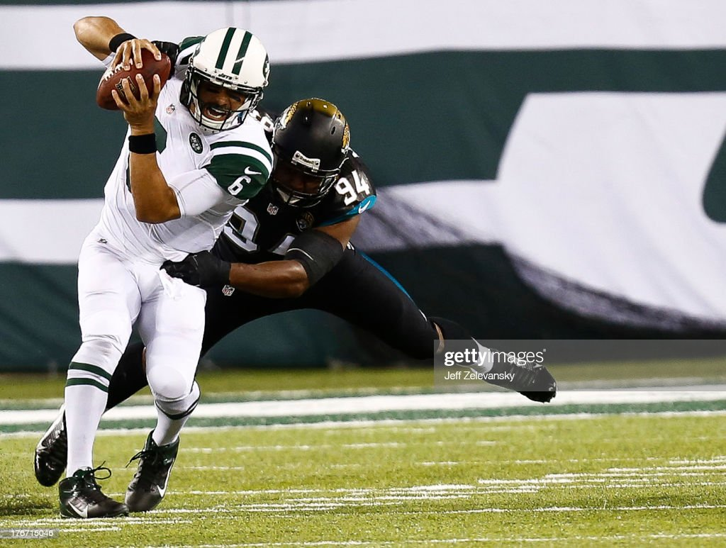 Jeremy Mincey #94 of the Jacksonville Jaguars sacks Mark Sanchez #6 of the New York Jets during their preseason game at MetLife Stadium on August 17, 2013 in East Rutherford, New Jersey.