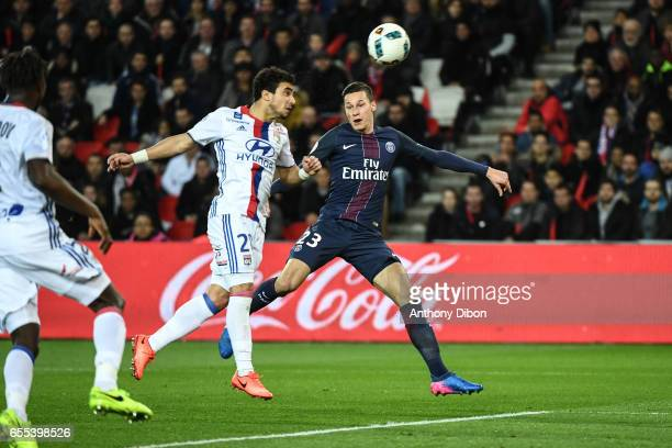 Jeremy Morel of Lyon and Julian Draxler of PSG during the French Ligue 1 match between Paris Saint Germain and Lyon at Parc des Princes on March 19...