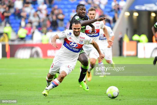 Jeremy Morel of Lyon and Marcus Thuram of Guingamp battle for possesion during the Ligue 1 match between Olympique Lyonnais and EA Guingamp at Parc...