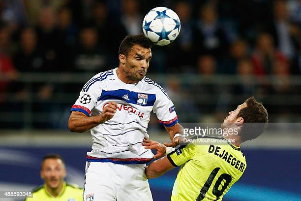 Jeremy Morel of Lyon heads the ball away from Brecht Dejaegere of Gent during the UEFA Champions League Group H match between KAA Gent and Olympique...