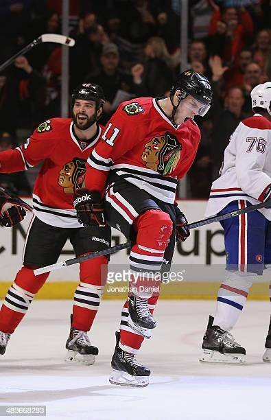 Jeremy Morin and Brandon Bollig of the Chicago Blackhawks celebrate Morin's third period goal against the Montreal Canadiens at the United Center on...