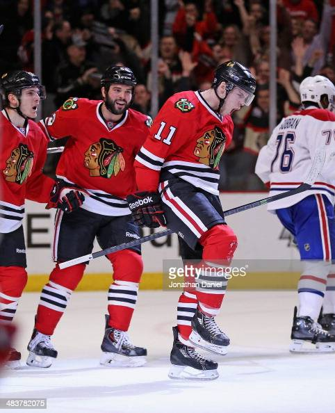 Jeremy Morin Brandon Bollig and Ben Smith of the Chicago Blackhawks celebrate Morin's third period goal against the Montreal Canadiens at the United...