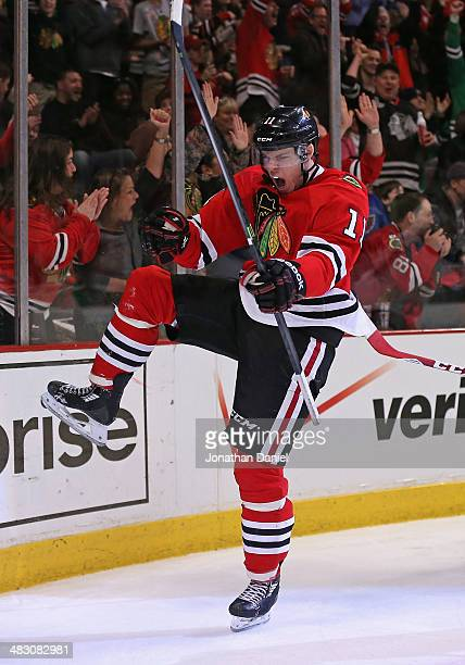Jeremy Morin of the Chicago Blackhawks celebrates a second period goal against the St Louis Blues at the United Center on April 6 2014 in Chicago...