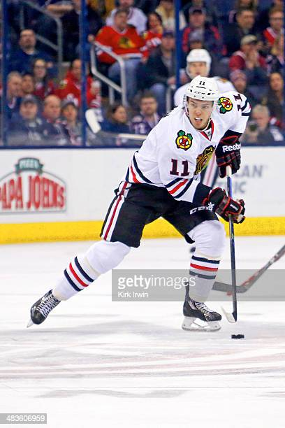 Jeremy Morin of the Chicago Blackhawks controls the puck during the game against the Columbus Blue Jackets on April 4 2014 at Nationwide Arena in...