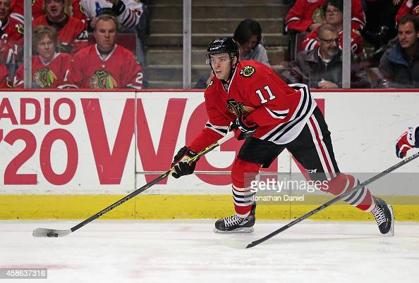 Jeremy Morin of the Chicago Blackhawks looks to pass against the Washington Capitals at the United Center on November 7 2014 in Chicago Illinois The...