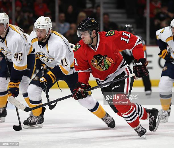 Jeremy Morin of the Chicago Blackhawks moves to the puck after a faceoff against the Nashville Predators at the United Center on March 23 2014 in...