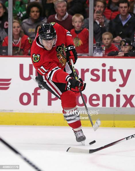 Jeremy Morin of the Chicago Blackhawks shoots against the Washington Capitals at the United Center on November 7 2014 in Chicago Illinois The...