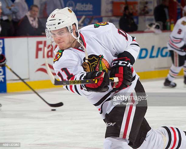 Jeremy Morin of the Chicago Blackhawks shoots the puck in warmups prior to the game against the Detroit Red Wings during a NHL game on November 14...
