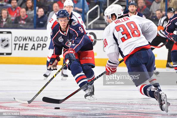 Jeremy Morin of the Columbus Blue Jackets attempts to knock the puck away from Jack Hillen of the Washington Capitals during the first period on...