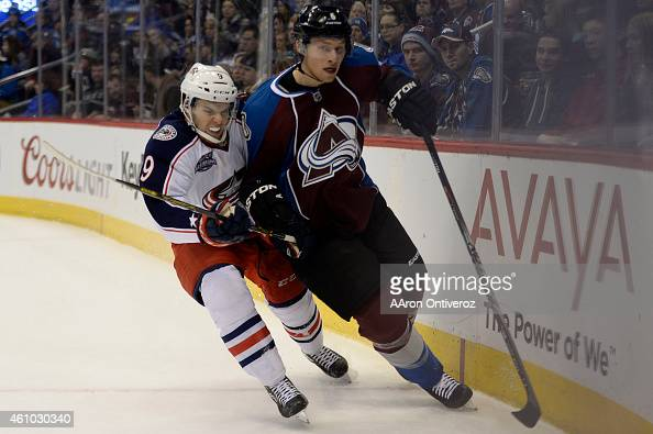 Jeremy Morin of the Columbus Blue Jackets checks Erik Johnson of the Colorado Avalanche during the fist period The Colorado Avalanche hosted the...