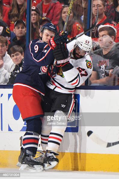 Jeremy Morin of the Columbus Blue Jackets checks Johnny Oduya of the Chicago Blackhawks against the boards during the second period on December 20...