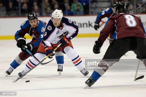 Jeremy Morin of the Columbus Blue Jackets controls the puck as Ryan O'Reilly of the Colorado Avalanche pursues during the second half of the Nuggets'...