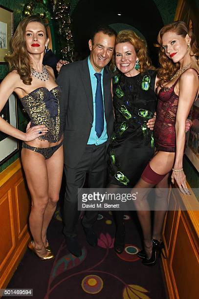 Jeremy Morris and Erin Morris pose with models at the David Morris and Agent Provocateur drinks reception hosted by Jeremy Morris and Lisa Tchenguiz...