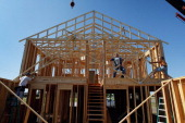 Jeremy Nelson with the help of construction workers rebuilds his home after it was destroyed when a tornado hit almost one year ago on May 21 2012 in...