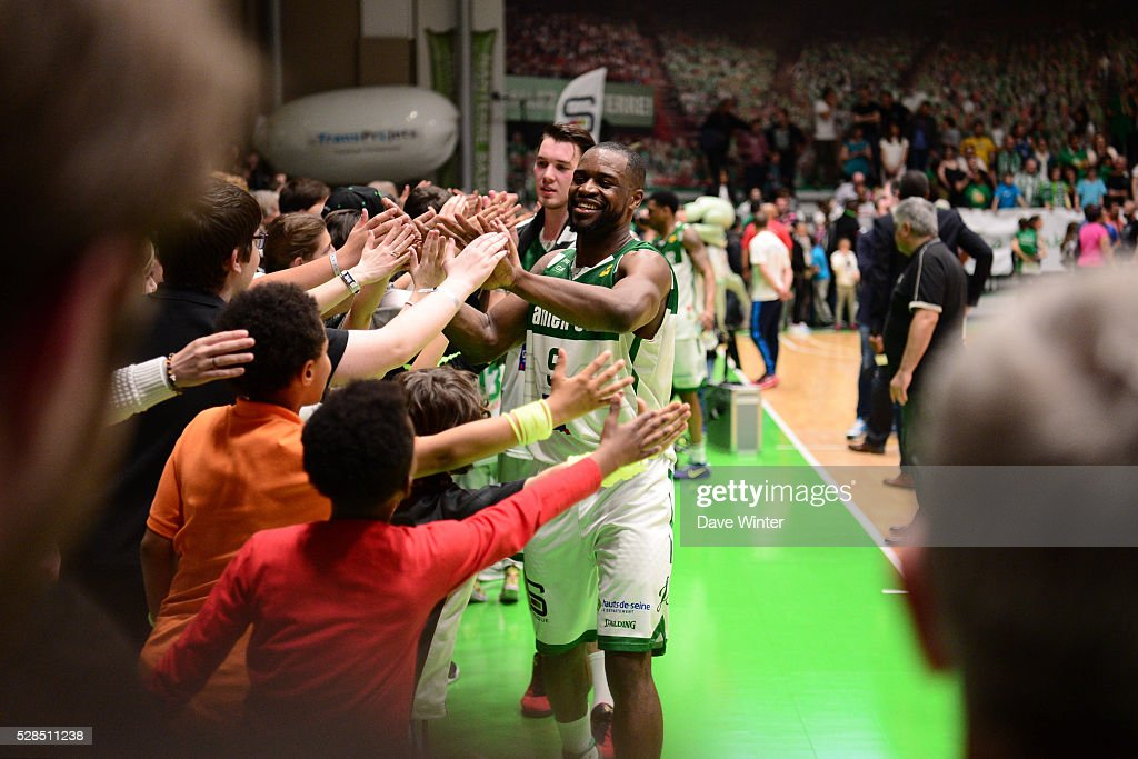 Jeremy Nzeulie of Nanterre celebrates with the fans as his team reach the end of season play offs during the basketball French Pro A League match between Nanterre and Paris Levallois on May 5, 2016 in Nanterre, France.