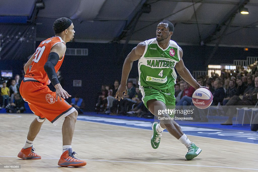 Jeremy Nzeulie of Nanterre is looking to pass the ball against DaShaun Wood of Le Mans during the game between Le Mans and Nanterre at Disney Events...