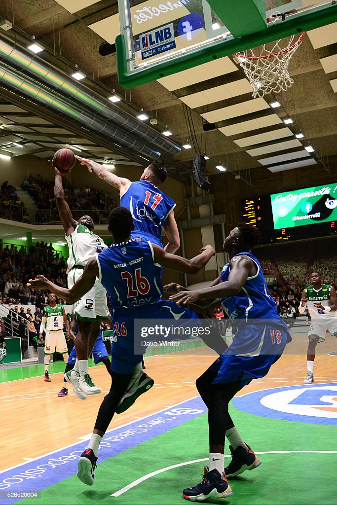 Jeremy Nzeulie of Nanterre (left) takes on the Paris Levallois defence of Vincent Poirier, Cyrille Eliezer Vanerot and Landing Sane of Paris Levallois during the basketball French Pro A League match between Nanterre and Paris Levallois on May 5, 2016 in Nanterre, France.