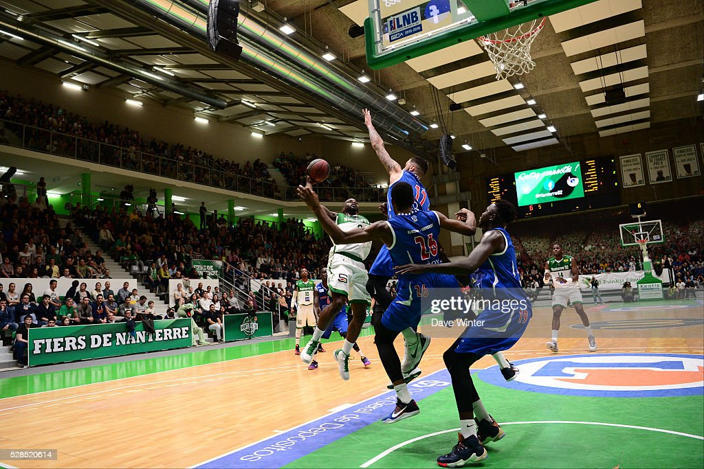 Jeremy Nzeulie of Nanterre (left) takes on the Paris Levallois defence during the basketball French Pro A League match between Nanterre and Paris Levallois on May 5, 2016 in Nanterre, France.