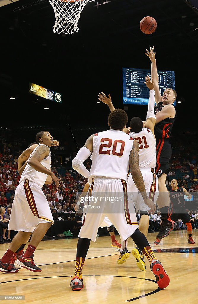 Jeremy Olsen #41 of the Utah Utes shoots over Aaron Fuller #21 and J.T. Terrell #20 the USC Trojans in the second half during the first round of the Pac 12 Tournament at the MGM Grand Garden Arena on March 13, 2013 in Las Vegas, Nevada. Utah defeated USC