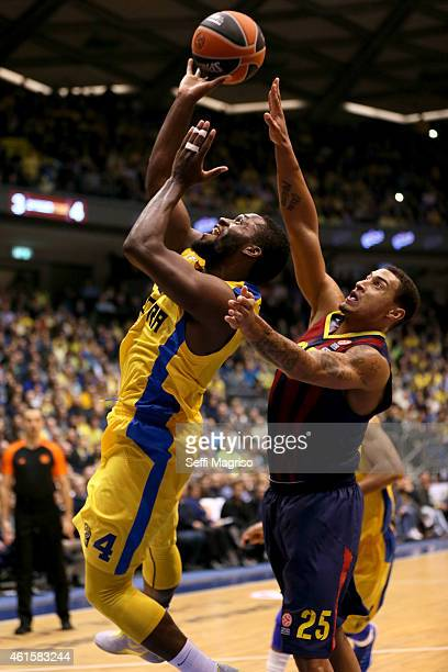 Jeremy Pargo #4 of Maccabi Electra Tel Aviv competes with Edwin Pierre Jackson #25 of FC Barcelona during the Euroleague Basketball Top 16 Date 3...