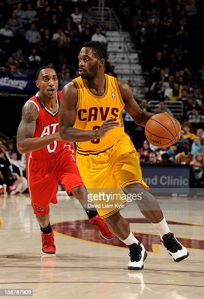 Jeremy Pargo of the Cleveland Cavaliers drives to the hoop against Jeff Teague of the Atlanta Hawks at The Quicken Loans Arena on December 28 2012 in...
