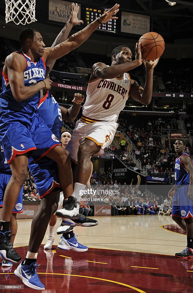 Jeremy Pargo #8 of the Cleveland Cavaliers passes from under the hoop against Thaddeus Young #21 of the Philadelphia 76ers at The Quicken Loans Arena on November 21, 2012 in Cleveland, Ohio.