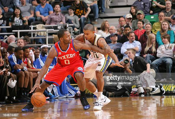 Jeremy Pargo of the Philadelphia 76ers controls the ball against Earl Watson the Utah Jazz at Energy Solutions Arena on March 25 2013 in Salt Lake...