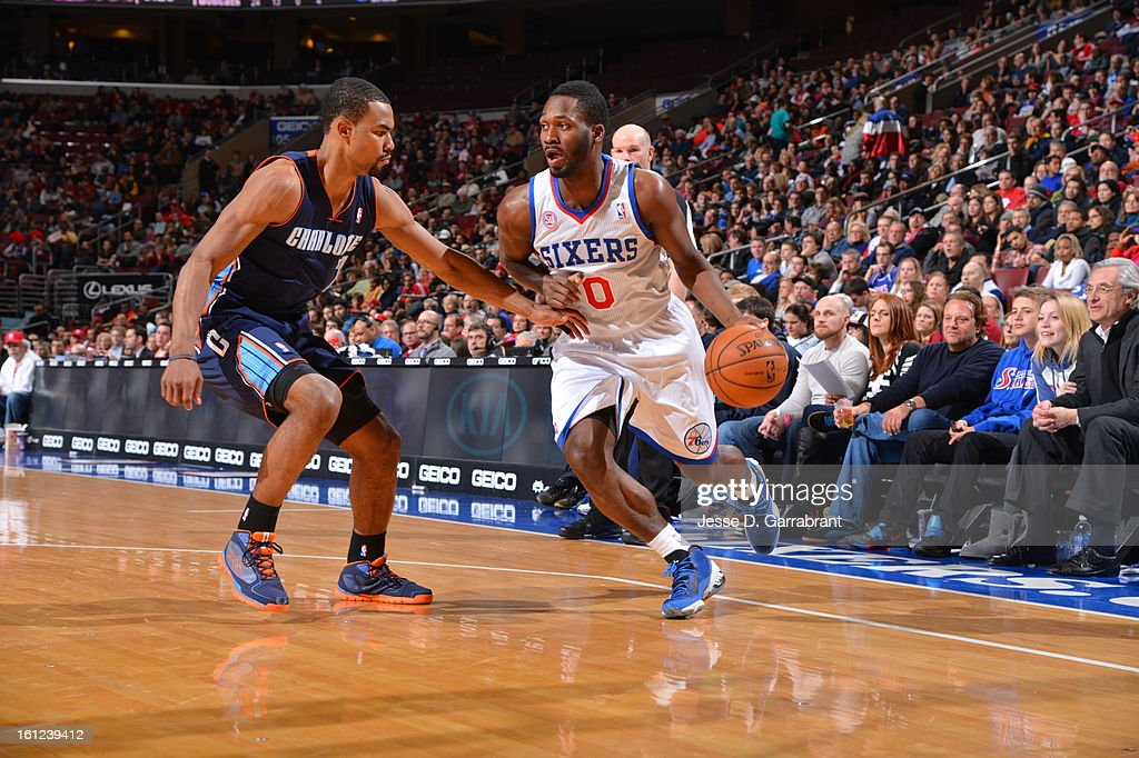Jeremy Pargo #0 of the Philadelphia 76ers dribbles to the basket against Ramon Sessions #7 of the Charlotte Bobcats during the game at the Wells Fargo Center on February 9, 2013 in Philadelphia, Pennsylvania.
