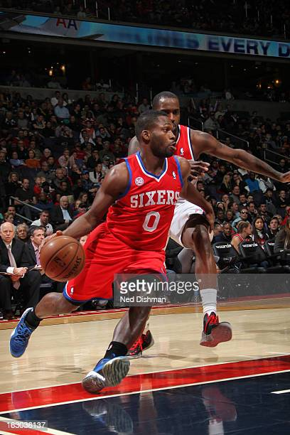 Jeremy Pargo of the Philadelphia 76ers drives against Martell Webster of the Washington Wizards during the game at the Verizon Center on March 3 2013...