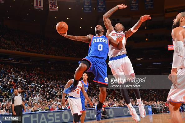 Jeremy Pargo of the Philadelphia 76ers drives to the basket against JR Smith of the New York Knicks on February 24 2013 at Madison Square Garden in...