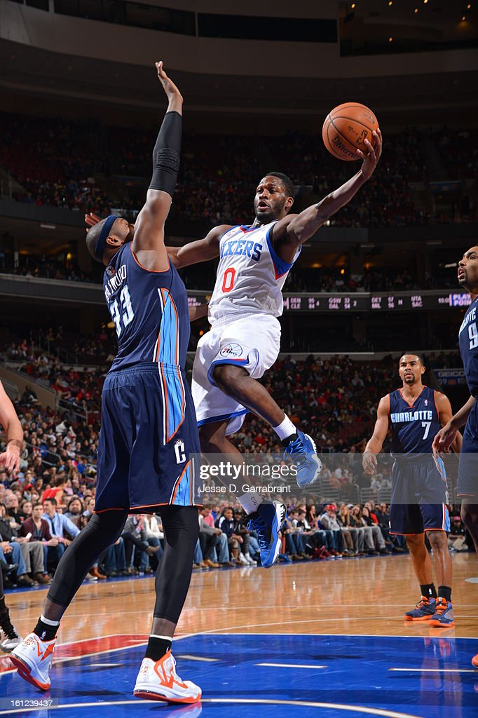 Jeremy Pargo #0 of the Philadelphia 76ers goes to the basket against Brendan Haywood #33 of the Charlotte Bobcats during the game at the Wells Fargo Center on February 9, 2013 in Philadelphia, Pennsylvania.