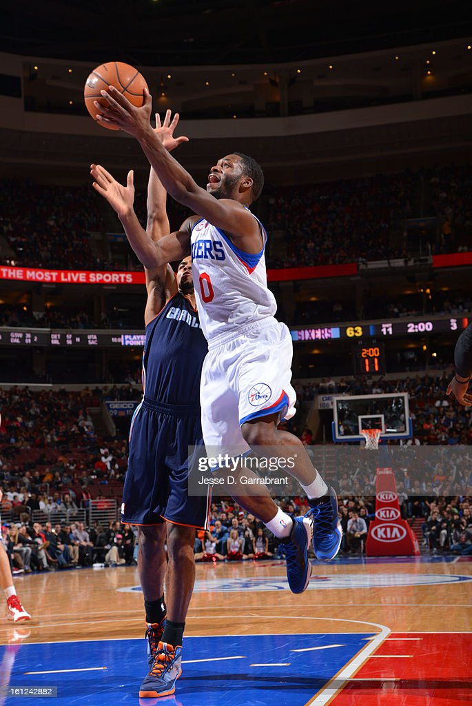 Jeremy Pargo #0 of the Philadelphia 76ers goes to the basket against the Charlotte Bobcats during the game at the Wells Fargo Center on February 9, 2013 in Philadelphia, Pennsylvania.