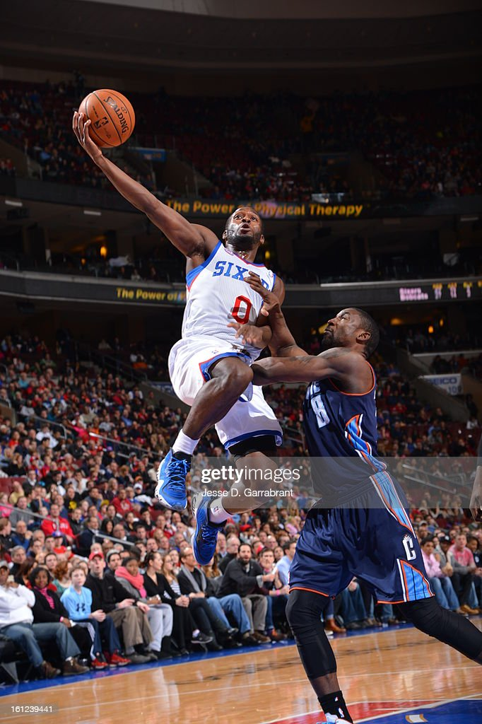 Jeremy Pargo #0 of the Philadelphia 76ers goes up for a dunk against Ben Gordon #8 of the Charlotte Bobcats during the game at the Wells Fargo Center on February 9, 2013 in Philadelphia, Pennsylvania.