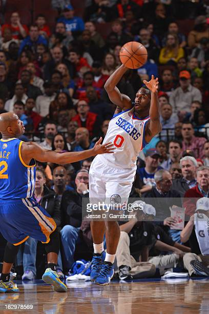 Jeremy Pargo of the Philadelphia 76ers passes the ball against Jarrett Jack of the Golden State Warriors on March 2 2013 at the Wells Fargo Center in...