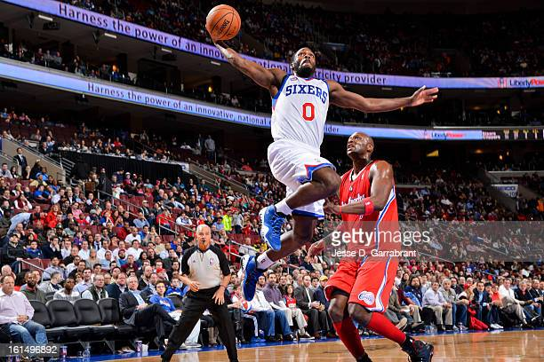 Jeremy Pargo of the Philadelphia 76ers rises for a dunk against Lamar Odom of the Los Angeles Clippers at the Wells Fargo Center on February 11 2013...