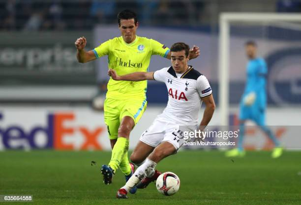Jeremy Perbet of KAA Gent closes down Harry Winks of Tottenham Hotspur during the UEFA Europa League Round of 32 first leg match between KAA Gent and...