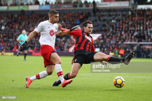Jeremy Pied of Southampton is challenged by Charlie Daniels of AFC Bournemouth during the Premier League match between AFC Bournemouth and...