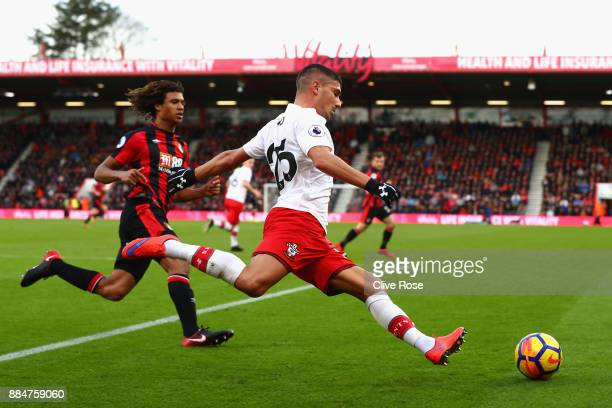 Jeremy Pied of Southampton is challenged by Nathan Ake of AFC Bournemouth during the Premier League match between AFC Bournemouth and Southampton at...