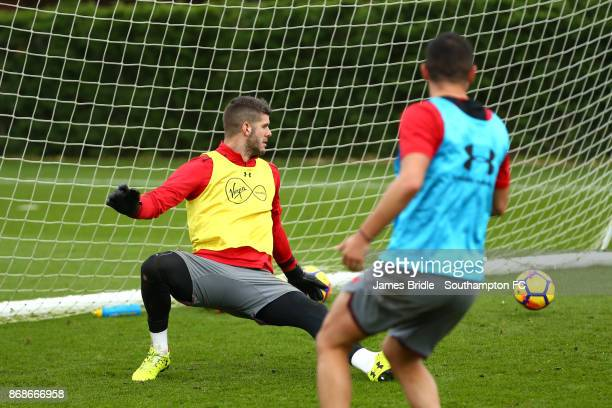 Jeremy Pied shoots at goal keeper Fraser Forster during training at Staplewood Complex on October 31 2017 in Southampton England