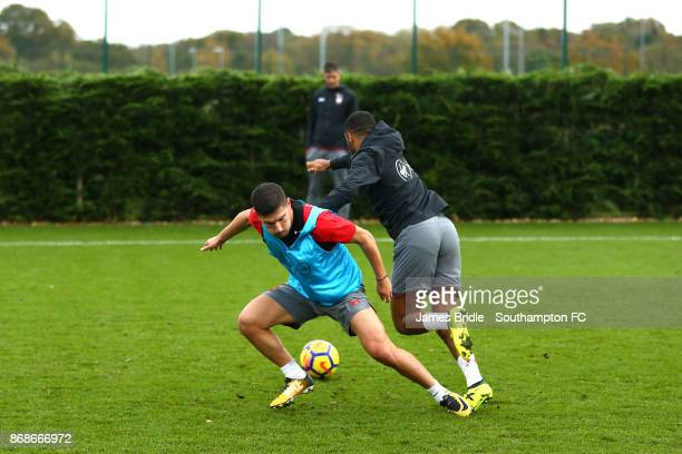 Jeremy Pied takes on Nathan Redmond while Mauricio Pellegrino stands in the background during training at Staplewood Complex on October 31 2017 in...