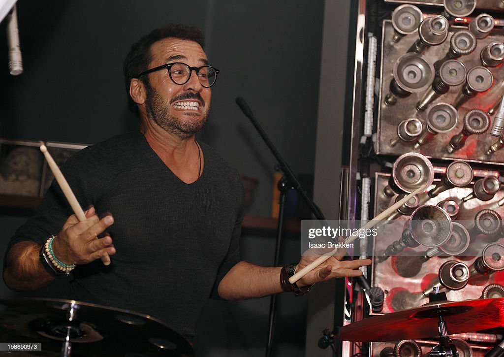 <a gi-track='captionPersonalityLinkClicked' href=/galleries/search?phrase=Jeremy+Piven&family=editorial&specificpeople=206338 ng-click='$event.stopPropagation()'>Jeremy Piven</a> plays the drums at Hyde Bellagio at the Bellagio on New Year's Eve January 1, 2013 in Las Vegas, Nevada.