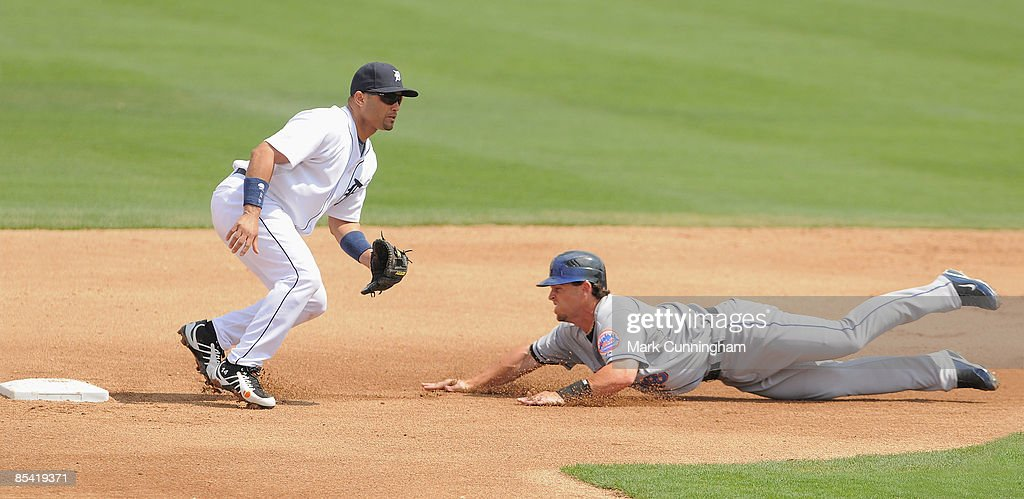 Jeremy Reed of the New York Mets slides into second base while Placido Polanco of the Detroit Tigers waits for the throw during the spring training...