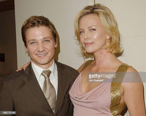 Jeremy Renner and Charlize Theron during 9th Annual Hollywood Film Festival Awards Gala Ceremony Backstage at Beverly Hilton Hotel in Beverly Hills...