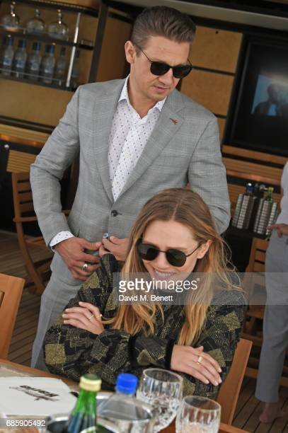 Jeremy Renner and Elizabeth Olsen attend a lunch hosted by Lexus for The Weinstein Company's 'Wind River' stars and director on May 20 2017 in Cannes...