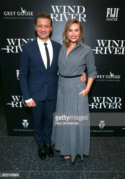 Jeremy Renner and Elizabeth Olsen attend The Weinstein Company With FIJI Grey Goose Lexus And NetJets Host A Screening Of 'Wind River' Arrivals at...
