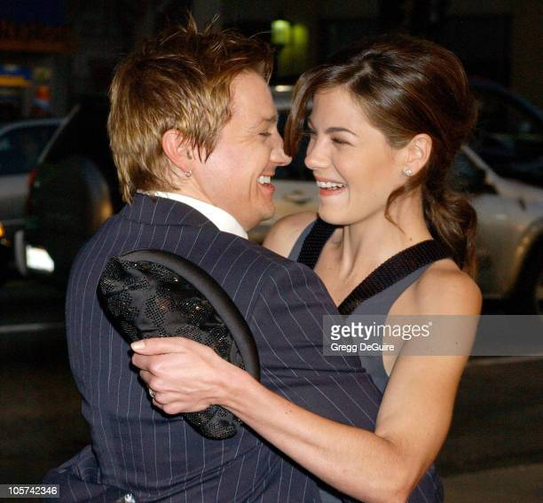 Jeremy Renner and Michelle Monaghan during Warner Bros Pictures' 'North Country' Los Angeles Premiere Arrivals at Grauman's Chinese Theatre in...