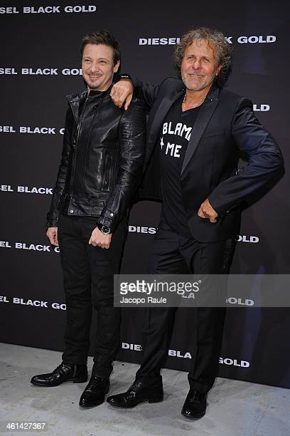 Jeremy Renner and Renzo Rosso attend Diesel Black Gold fashion show during Pitti Immagine Uomo 85 on January 8 2014 in Florence Italy