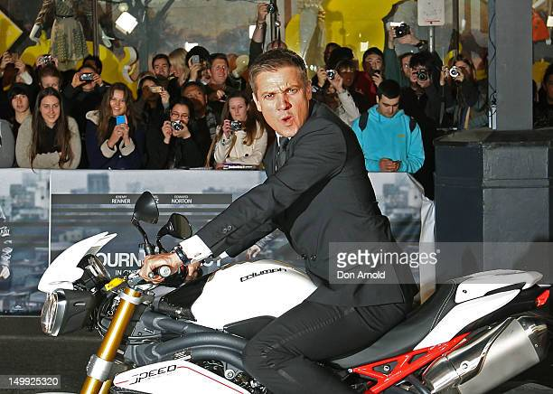 Jeremy Renner arrives by motorbike for the Sydney Premiere of The Bourne Legacy at the State Theatre on August 7 2012 in Sydney Australia